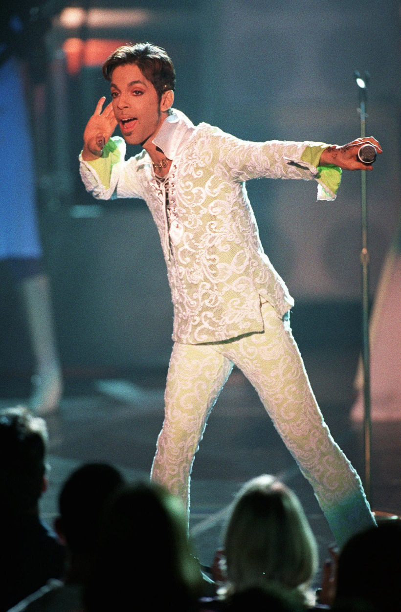 """FILE - In this April 10, 1997 file photo, Prince performs a medley of """"Take Me With U"""" and """"Rasberry Beret"""" at the 4th annual VH1 Honors in Universal City, Calif. Prince's publicist has confirmed that Prince died at his home in Minnesota, Thursday, April 21, 2016. He was 57. (AP Photo/Mark J. Terrill, File)"""
